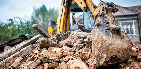 Hydraulic crusher excavator working on site demolition